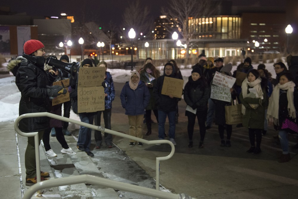 Professor of Spanish and Portuguese Studies Mary Pogatshnik addresses demonstrators outside Coffman Union on Thursday, Feb. 8 in protest of a change to the student conduct code.