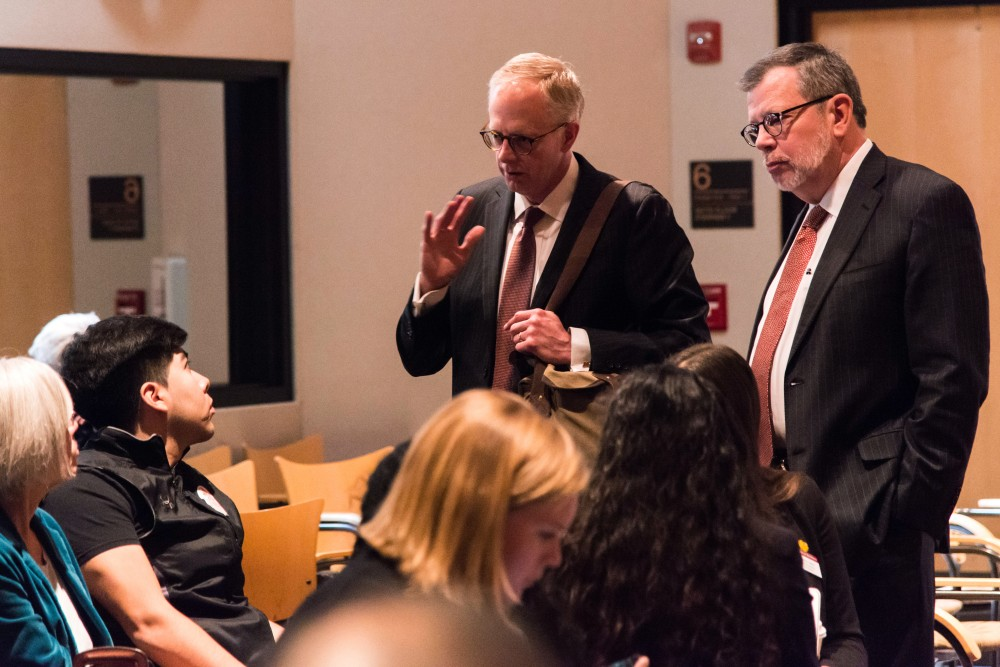 <p>A group of students air grievances to University President Eric Kaler and Regent David McMillan during the Board of Regents meeting on Friday, Feb. 9. Their concerns stem from a possible change in the Student Conduct Code.</p>