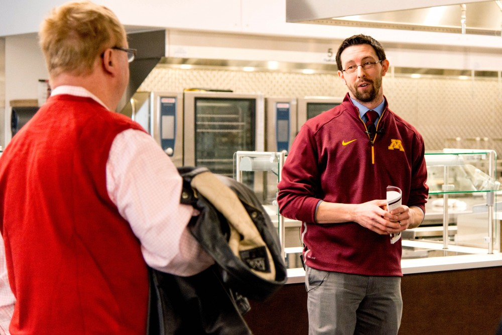 Jake Ricker, director of strategic communications for UMN Athletics, answers a question about the Athletes Village's Nutrition Center during a tour on Saturday, Feb. 10. Once open, the center will be available to all UMN students as a weekday dining hall.