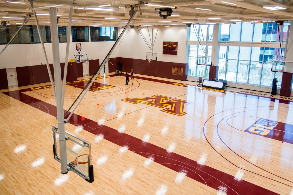 Athletes use the Robert K. Eddy Practice Court during a tour on Saturday, Feb. 10. The court is a replica of the Williams Arena floor with additional space and ball racks built into the walls.