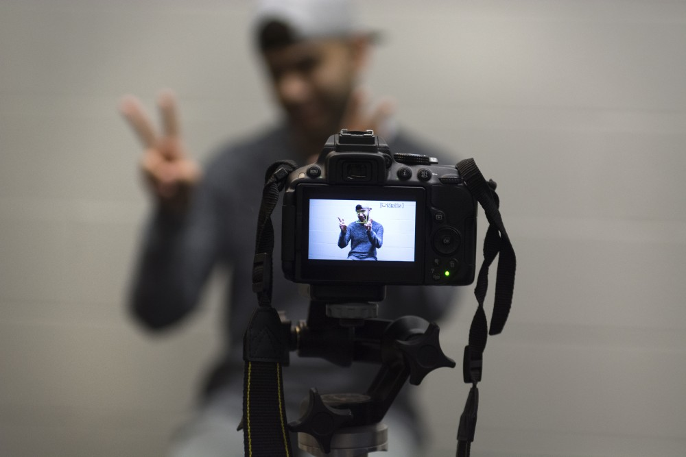 Interviewee Samad Qureshi makes air quotes with his hands while talking about his experience with mental health stigmas on Saturday, Feb. 10 as a part of a video profile series on Indian students at the University created by the Indian Student Association.