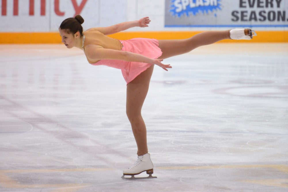 Freshman Olivia Kaus competes in the Novice Free Skate group during the first collegiate-level skating competition hosted by the figure skating club at 3M Arena at Mariucci on Sunday, Feb. 11.
