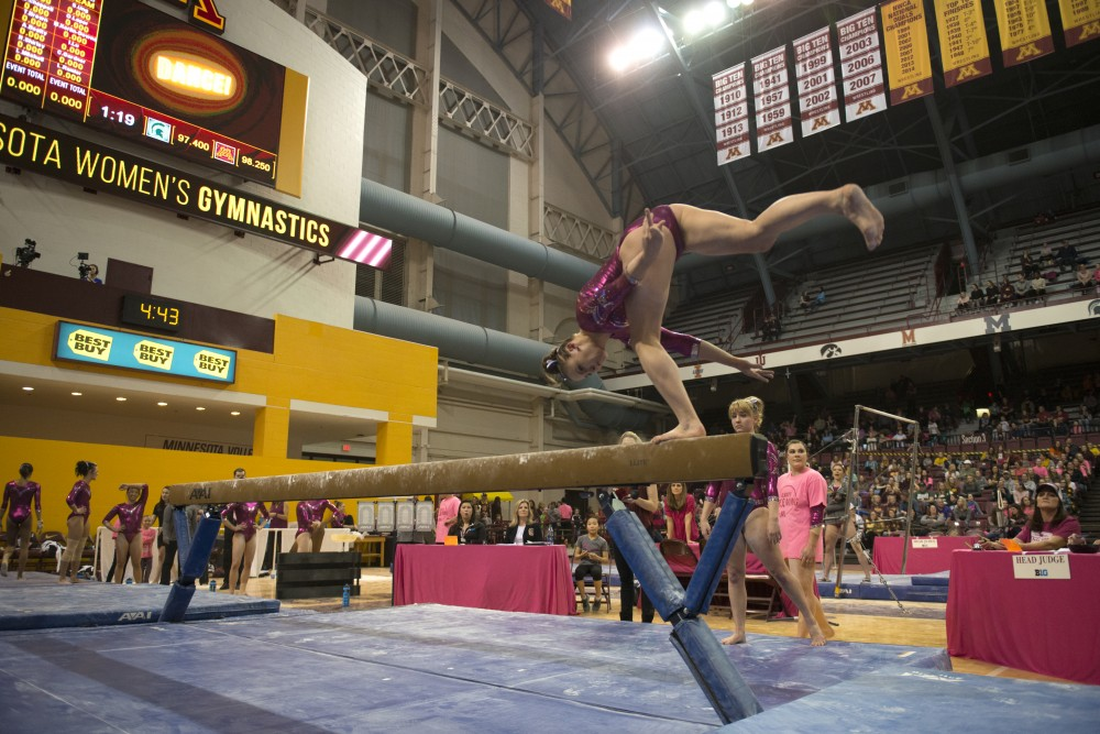 Lexy Ramler performs her beam routine at the Maturi Pavilion on Saturday, Jan. 20, 2018.