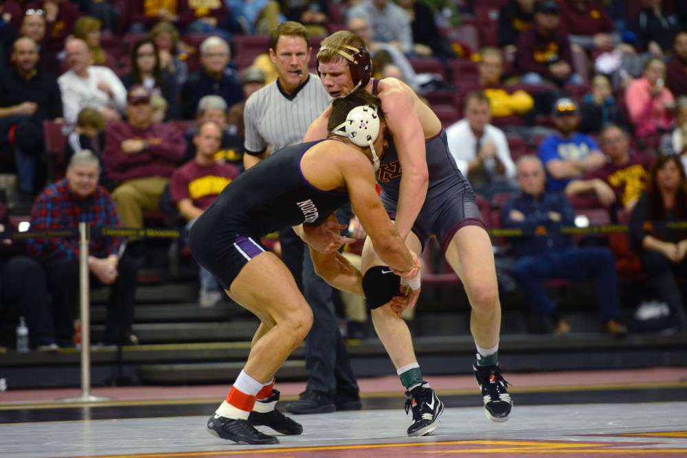 Senior Chris Pfarr at 174 takes on Northwestern's Johnny Sebastian during the match on Sunday, Jan. 28 at Maturi Pavillion.
