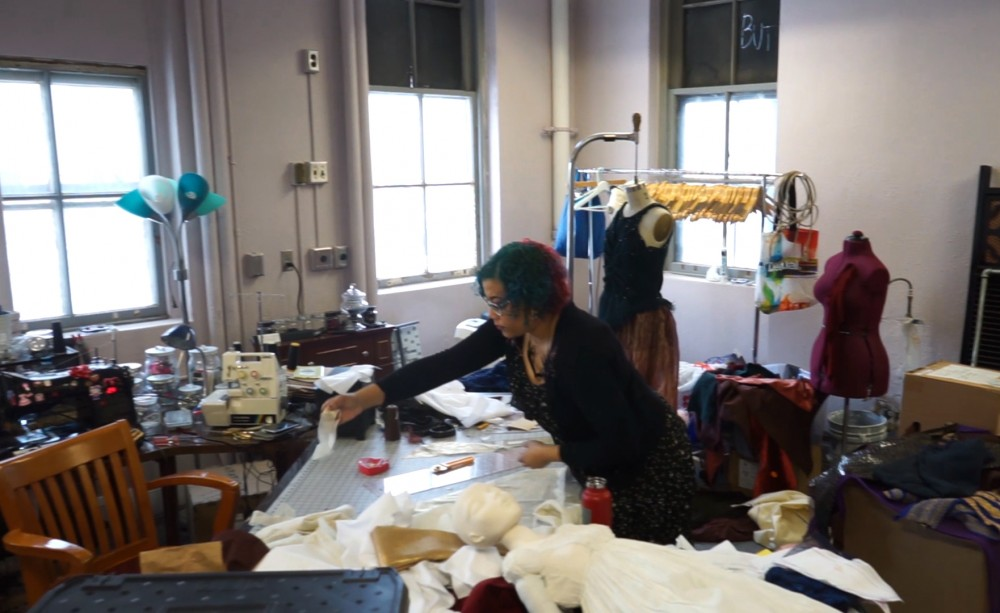 Local fashion designer Samantha Rei works in her studio on Monday, Feb. 12. Rei was a competitor on Season 16 of 'Project Runway'.