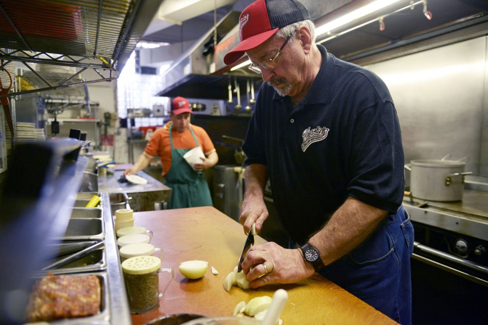 Vescio's owner Frank Vescio prepares a take out order for a customer on Wednesday, May 8, 2013, in Dinkytown.