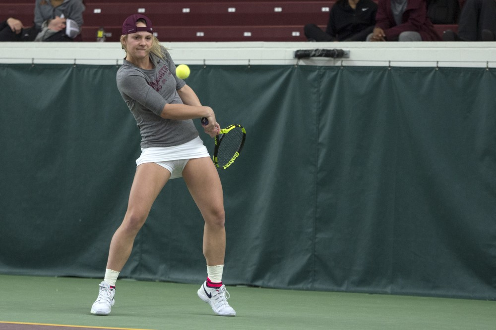 Junior Barbara Mancera returns the ball during her singles match against the University of South Dakota at the Baseline Tennis Center on Friday, Feb. 9.