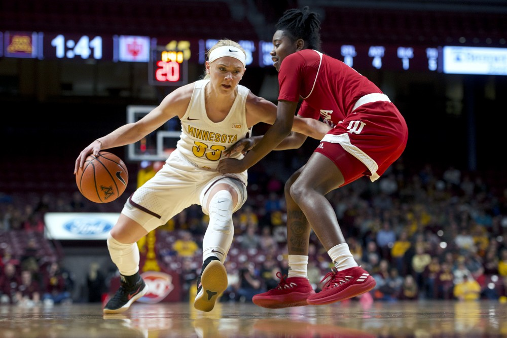 Guard Carlie Wagner maneuvers around an Indiana player during the game on Tuesday, Feb. 20 at William's Arena.