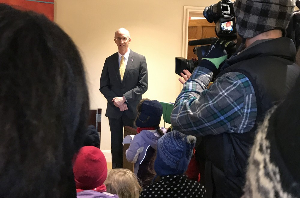 <p>Parents and children from the University Child Development Center gather around Vice President of University Relations Matt Kramer in University President Eric Kaler's office in Morrill Hall on Thursday, Feb. 8.</p>