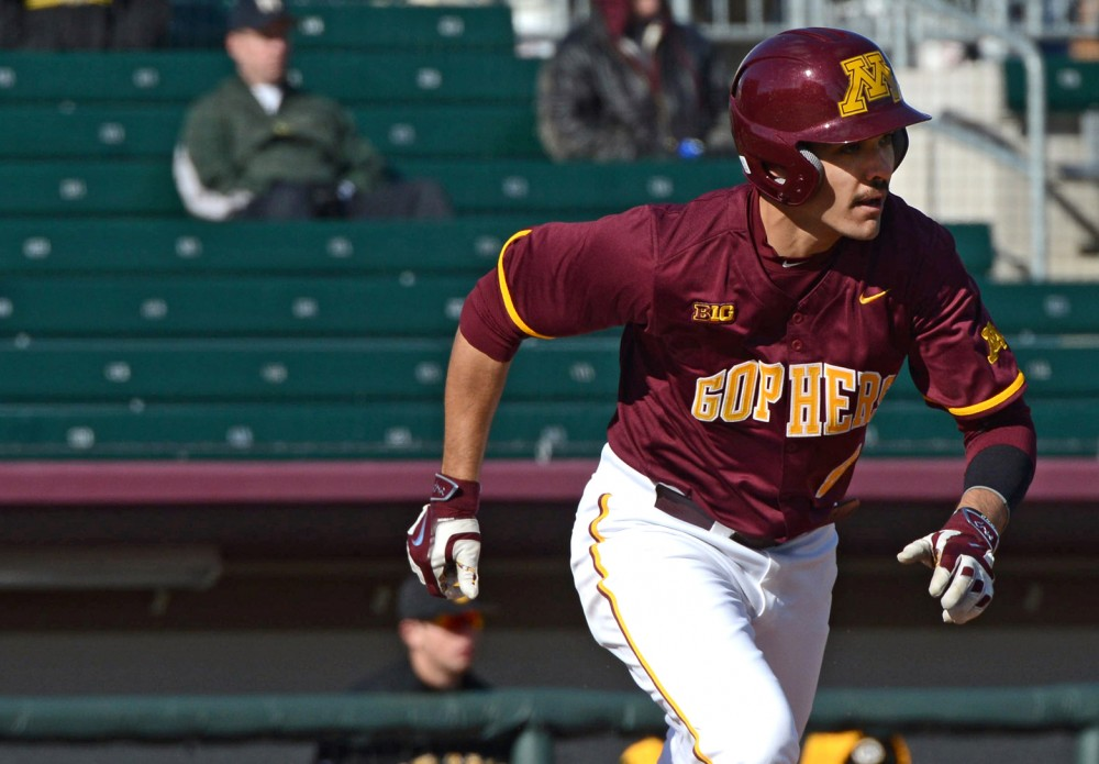 Infielder Micah Coffey runs to first during a game at Siebert Field on Apr. 1, 2016.