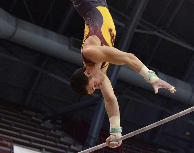 <p>Senior Tristan Duran competes on the high bar during a meet on March 25, 2017 at Maturi Pavilion. </p>