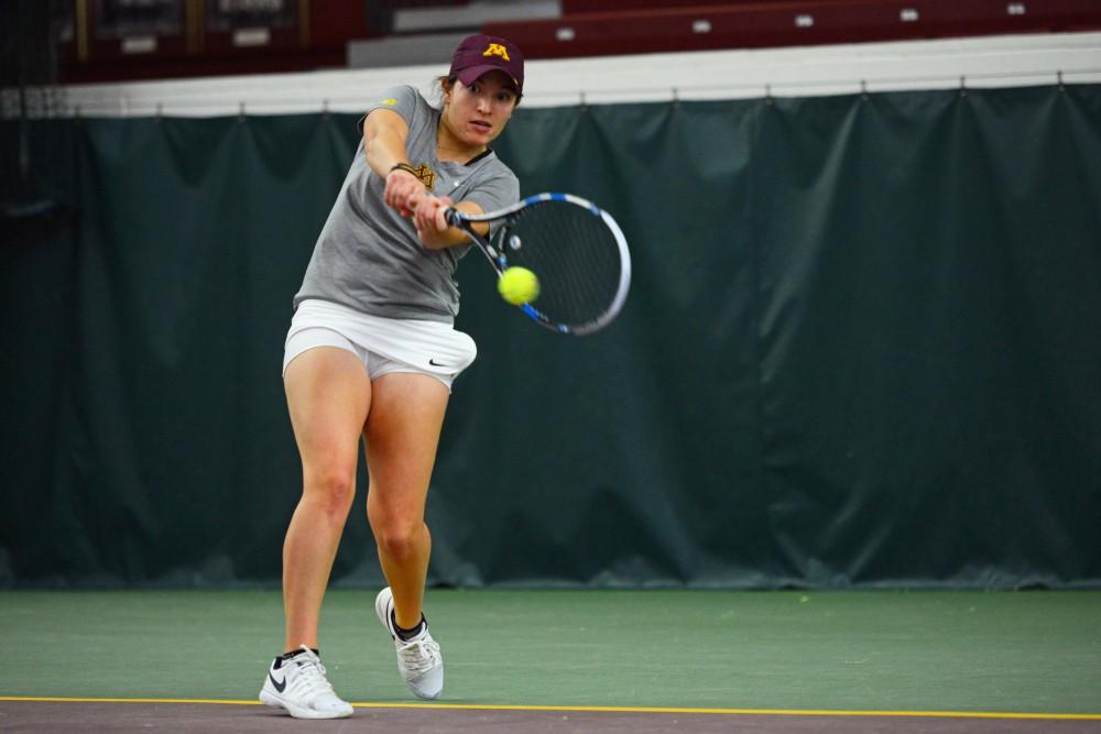Junior Caitlyn Merzbacher returns the ball during her singles match against the University of South Dakota at the Baseline Tennis Center on Friday, Feb. 9.