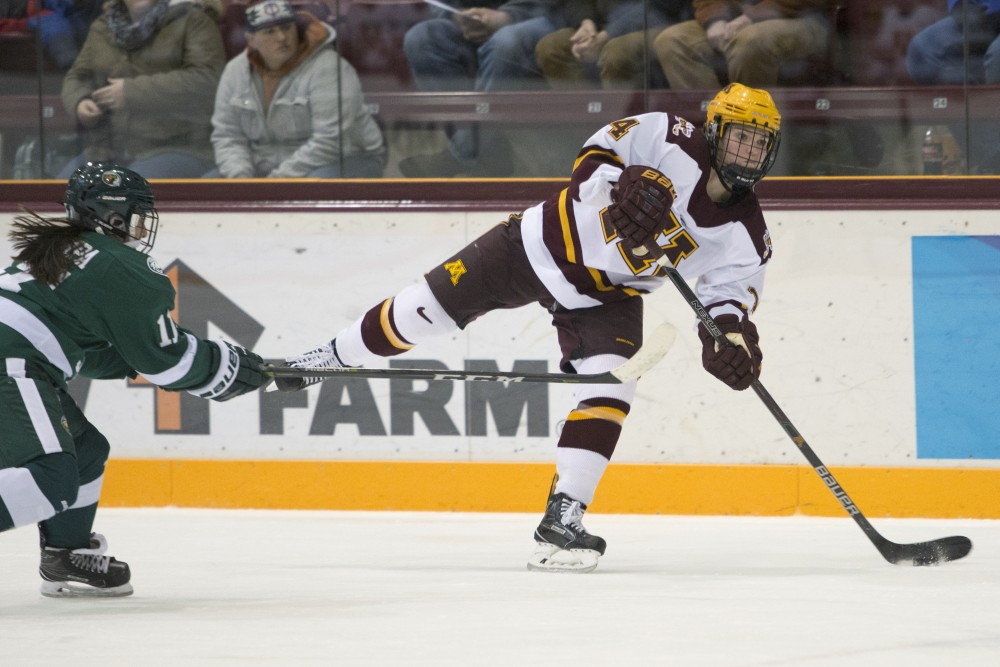 Forward Lindsay Agnew passes the puck during a game against Bemidji State on Dec. 12, 2017.