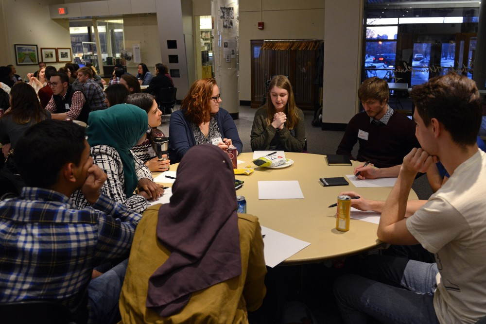 Participants engage in conversation at the White Supremacy in the Age of Trump Anti-Racist Teach In at the Humphrey Forum on Monday, Feb. 26.