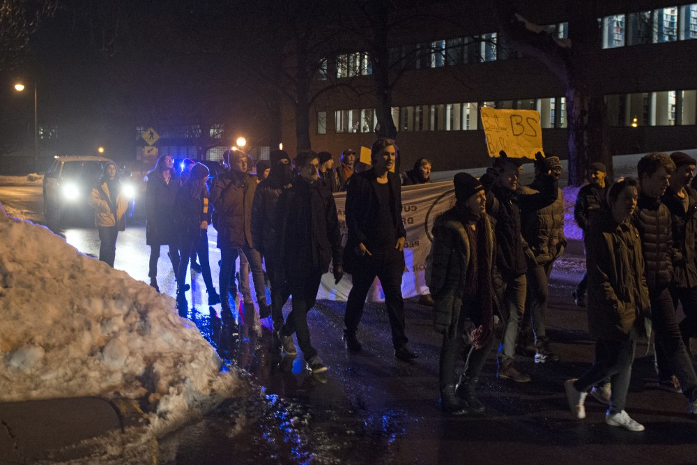 Protesters march in the streets around the St.Paul Student Center in opposition to conservative commentator Ben Shapiro's appearance on campus out on Monday, Feb. 26.