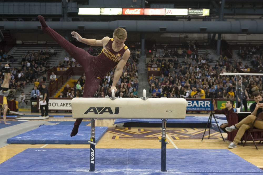Freshman gymnast Shane Wiskus performs on the pommel horse during a meet on Jan. 27, 2018 at Maturi Pavilion.