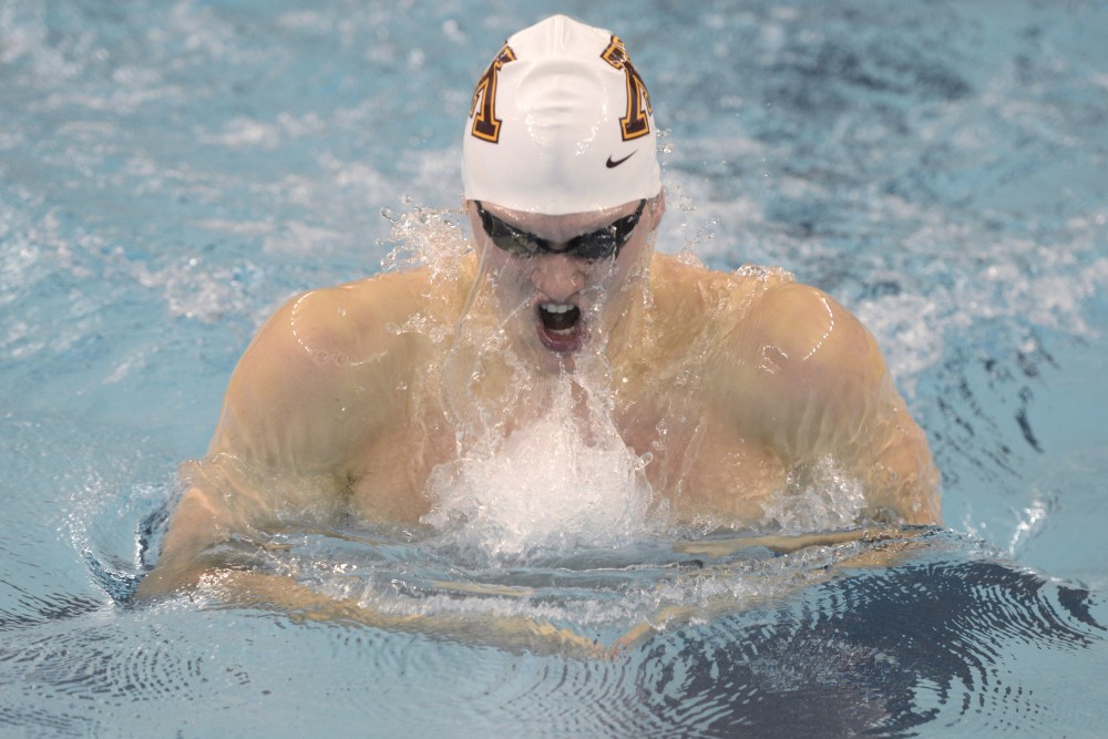 Senior Conner McHugh swims the 200 Yard Breaststroke during the Minnesota Invitational on Saturday, Dec. 2, 2017 at the Jean K Freeman Aquatic Center.