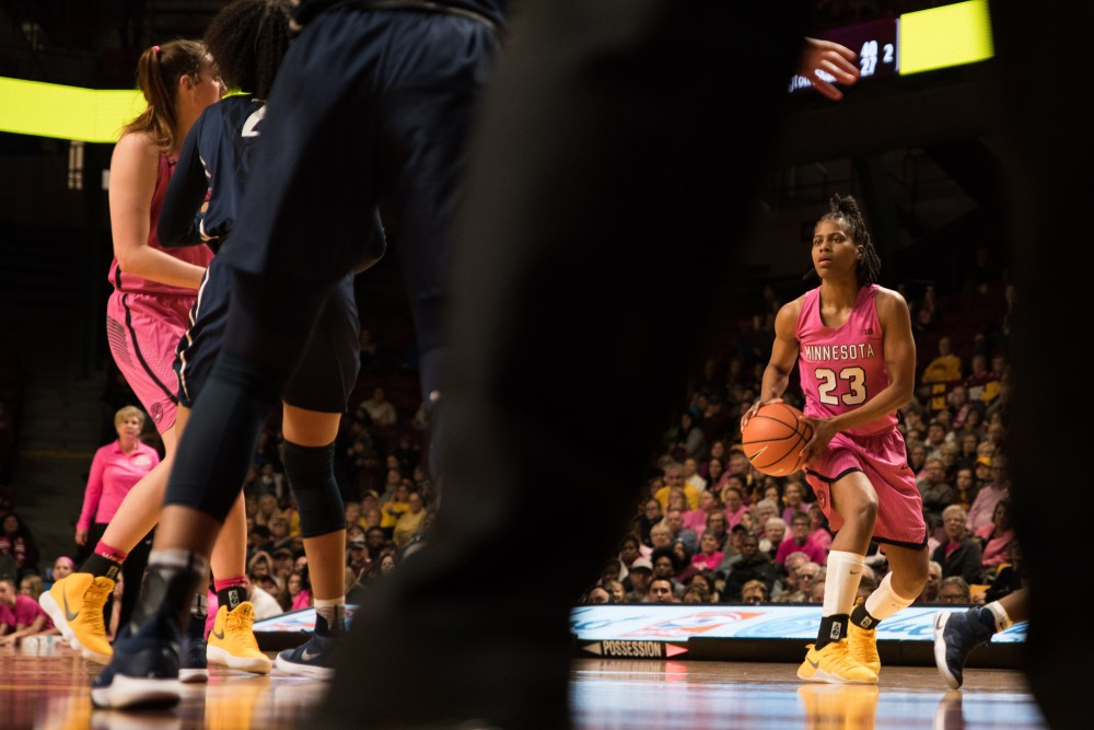 Gophers guard Kenisha Bell moves the ball up the court during Minnesota's game against Penn State on Sunday. The Gophers won 101-68.