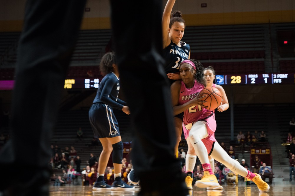 Gophers guard Jasmine Brunson moves the ball up the court during Minnesota's game against Penn State on Sunday. The Gophers won 101-68.