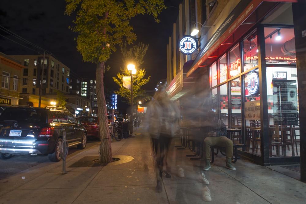 Pedestrians walk through Dinkytown on Oct. 13, 2017.