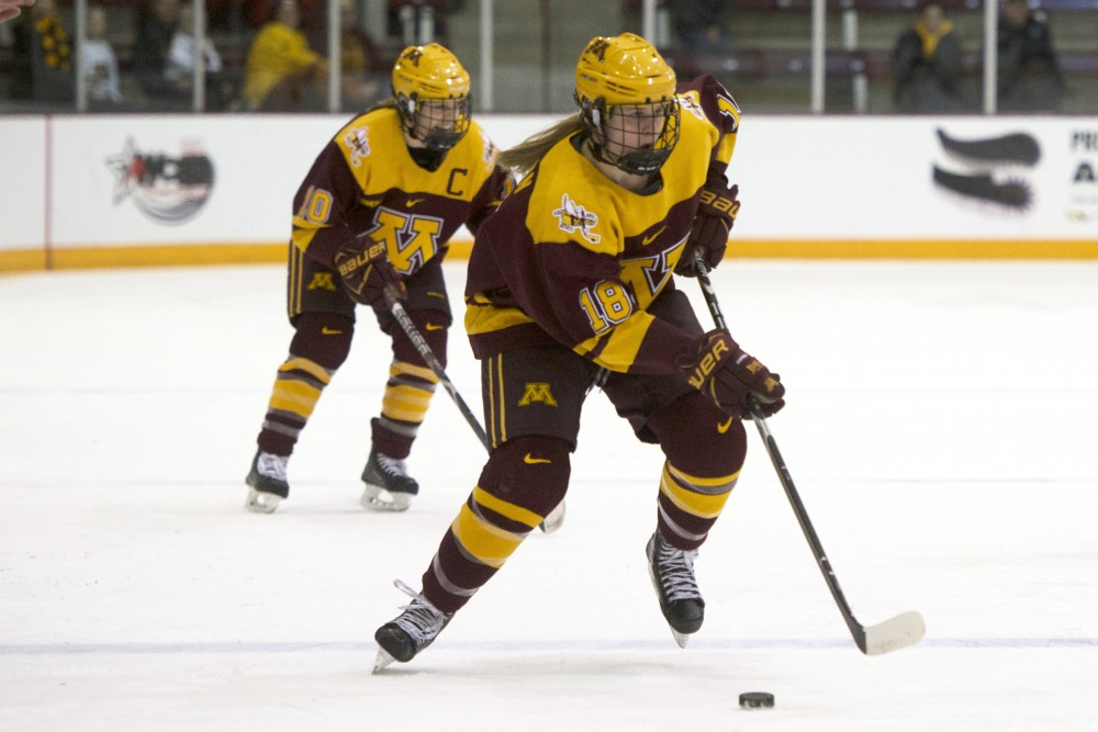 Defenseman Katie Robinson and forward Cara Piazza skate down the ice during a game against Ohio State for the WCHA Final Faceoff semifinal on Sat. Mar. 3, 2018, at Ridder Arena.