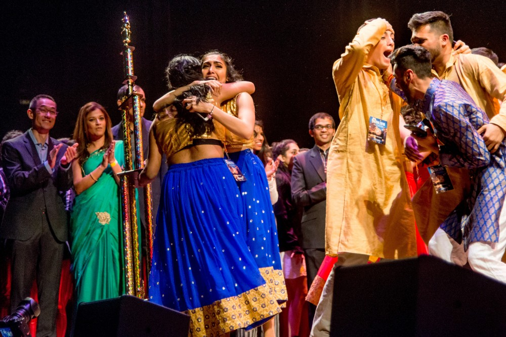 UCLA's Bollywood and Hindi-film dance team Nashaa celebrates after winning first place at Jazba 2018 on Saturday March 3. The team won over judges with its complex choreography, creative lighting displays, and compelling story of forbidden love.
