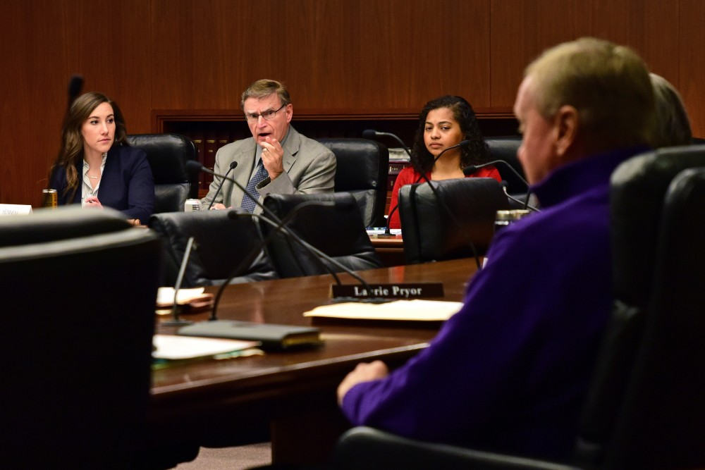 Minnesota House of Representatives Committee on Higher Education Chair Bud Nornes speaks to Rep. Gene Pelowski during the committee's hearing on the University's Board of Regents selection process at the Minnesota State Office Building on Wednesday, Feb. 28.