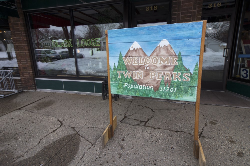 A recreation of the fictional town of Twin Peaks welcome sign stands outside Nancy Wallers Black Lodge, a shop dedicated to David Lynchs series centered around the town.