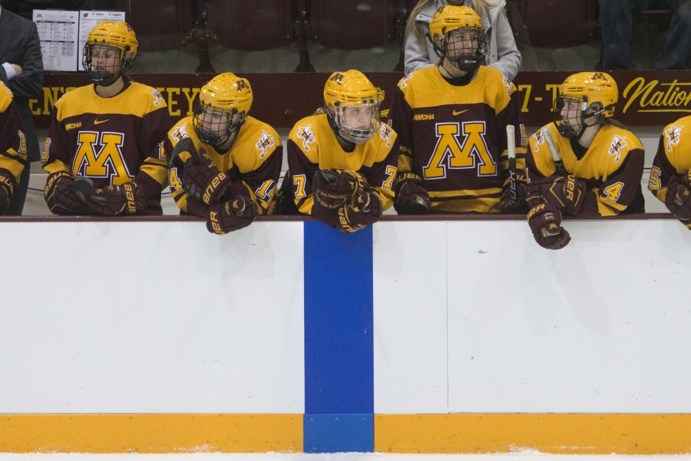 Forward Taylor Williamson, center, watches the 2018 WCHA Final on March 4, 2018.