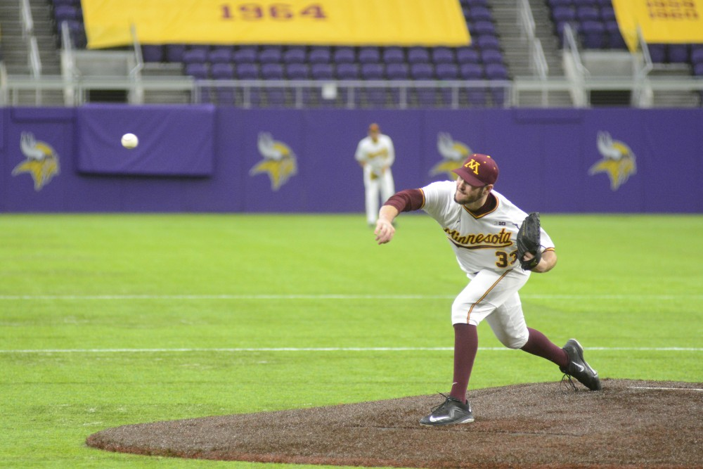 Gophers pitcher Toby Anderson throws a pitch during a game against Iowa on Sunday, March 5 at U.S. Bank Stadium.