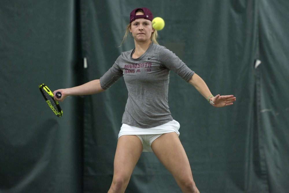 Junior Barbara Mancera returns the ball during her singles match against the University of South Dakota at the Baseline Tennis Center on Friday, Feb. 9.