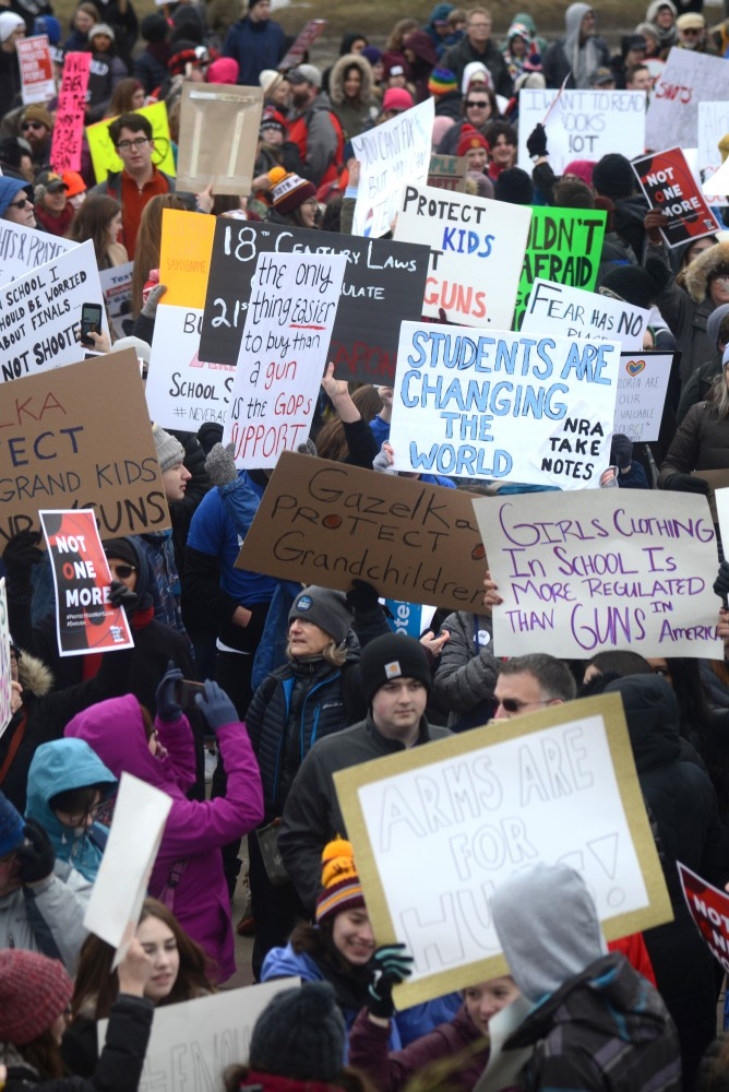 Gun control advocates hold a sea of signs at Harriet Island Regional Park for March for Our Lives Minnesota on Saturday, March 24.