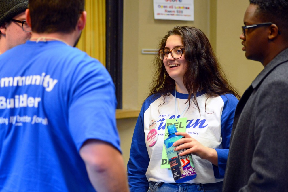 Senior Sonia Neculescu speaks with other student organizers at the DFL Convention at Edison High School in northeast Minneapolis on Saturday, March 24. Neculescu, a University of Minnesota senior, won the position of chair of Senate District 60.