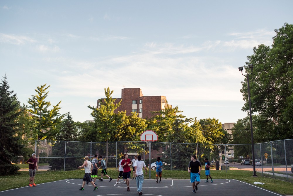 A group plays a game of pick-up basketball at Holmes Park located in the Marcy-Holmes neighborhood of Minneapolis. The Minneapolis Park and Recreation Board has money designated for renovations that are set to start in 2018.