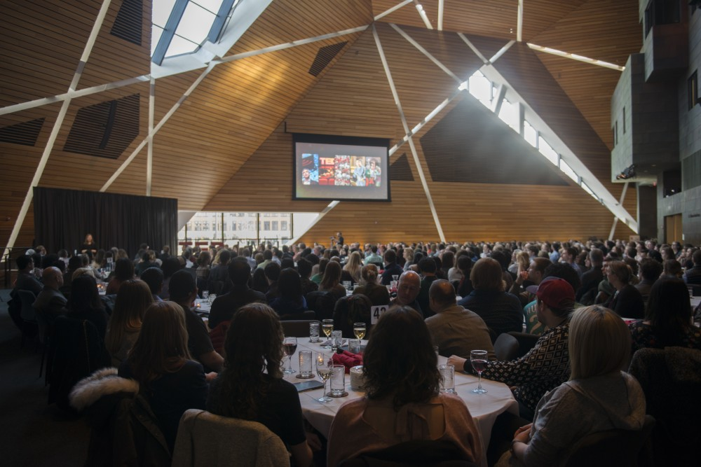 Attendees of TEDxUMN: A Tale of Twin Cities wait for the first speech to begin at McNamara Alumni Center on Friday, March 30.