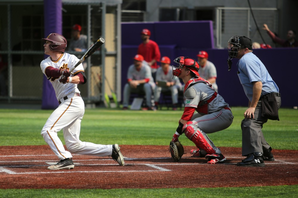 Catcher Eli Wilson swings during the game against St. John's University on Saturday, March 31 at U.S. Bank Stadium in Minneapolis. The Gophers won 6-3.