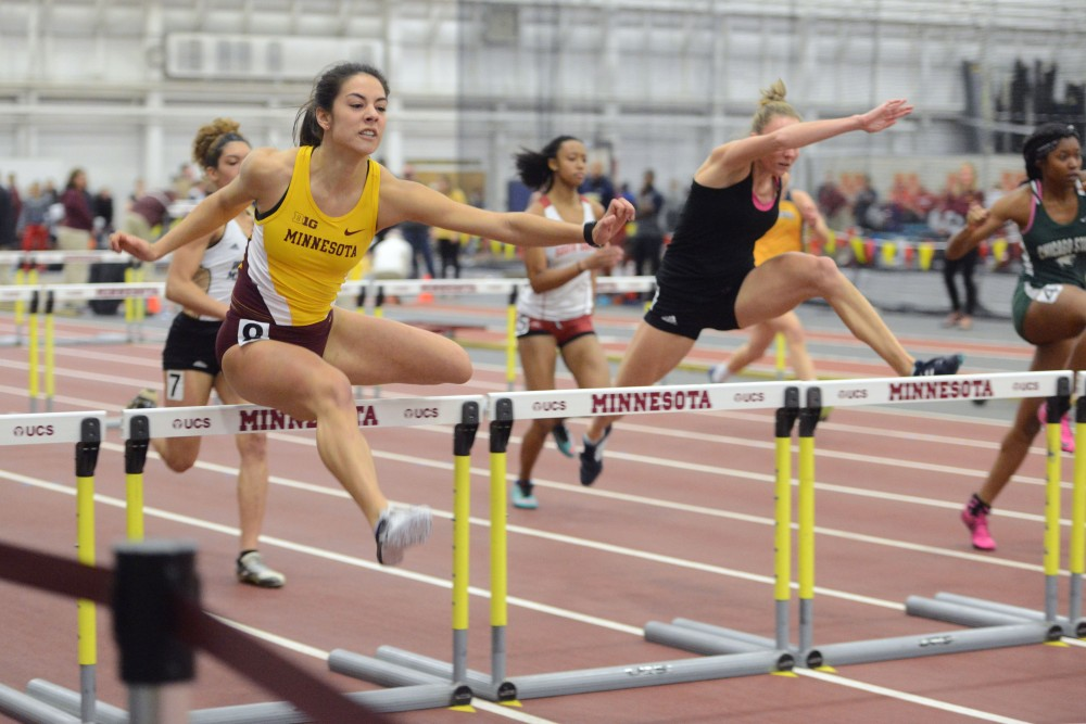 Redshirt freshman Rachel Schow clears a hurdle on Jan. 28, 2017 at the Field House.