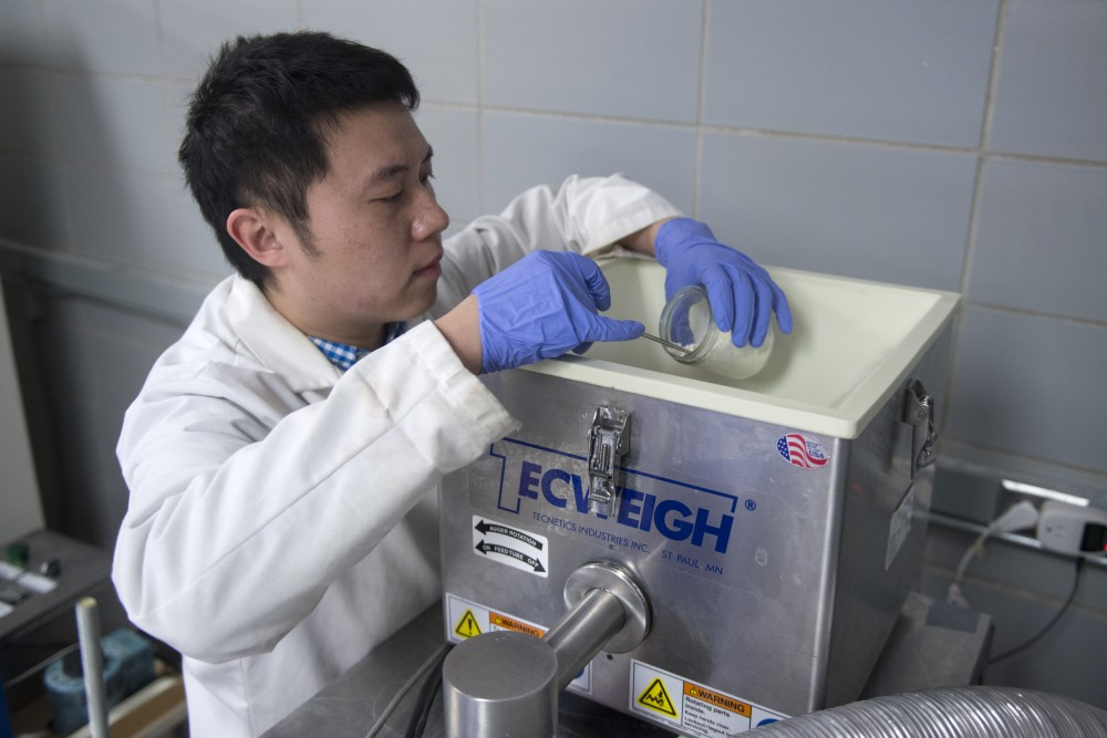 Researcher Dongjie Chen begins the Intense Pulsed Light process which removes bacteria from powdered foods in the Food Science and Nutrition building on Tuesday, April 3.