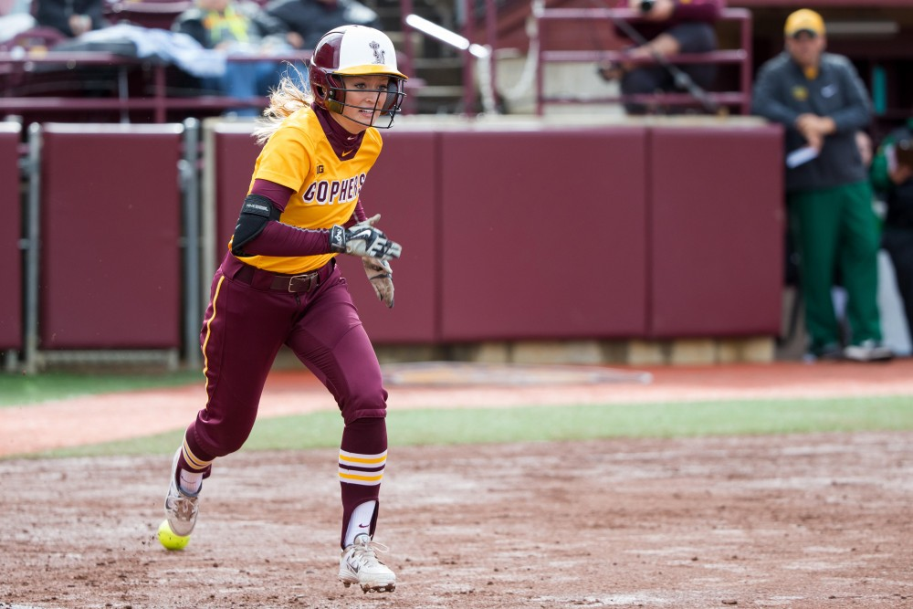 Freshman outfielder Ellee Jensen runs to first base in a game at Siebert Field.