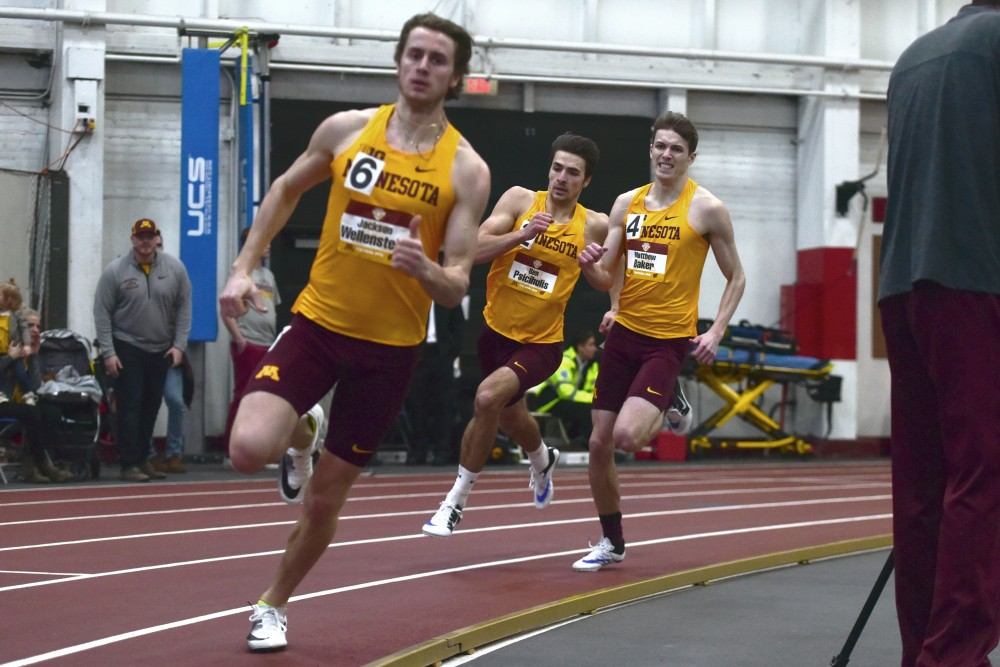 Gophers Jackson Wellenstein, Ben Psicihulis, and Matthew Baker compete in the 4x400-meter relay during the Border Battle on Jan. 13.