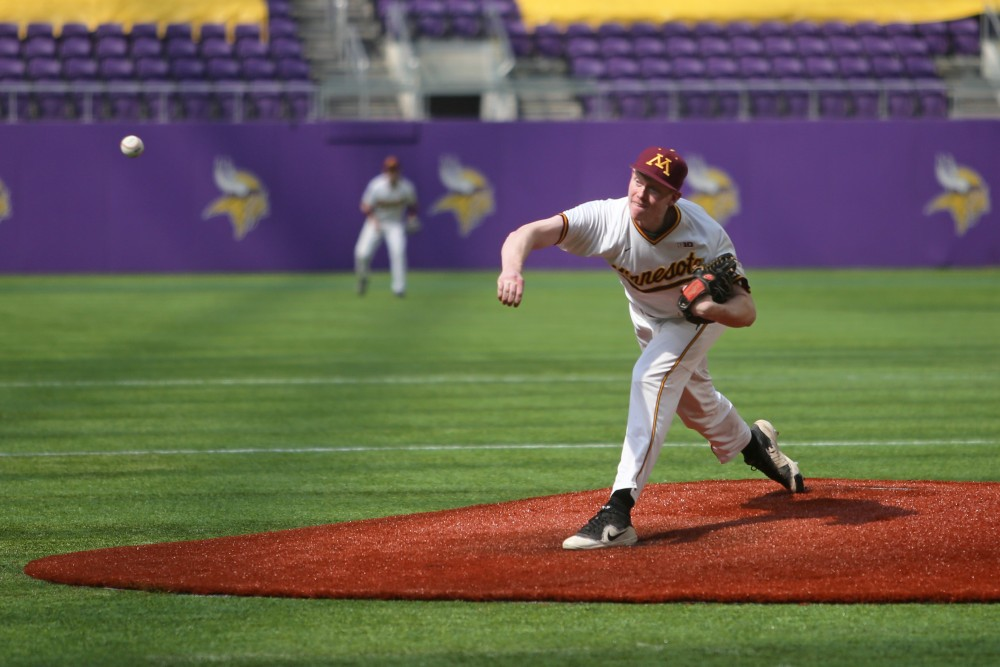 Freshman Patrick Fredrickson pitches during the game against St. John's University on Saturday, March 31 at U.S. Bank Stadium.