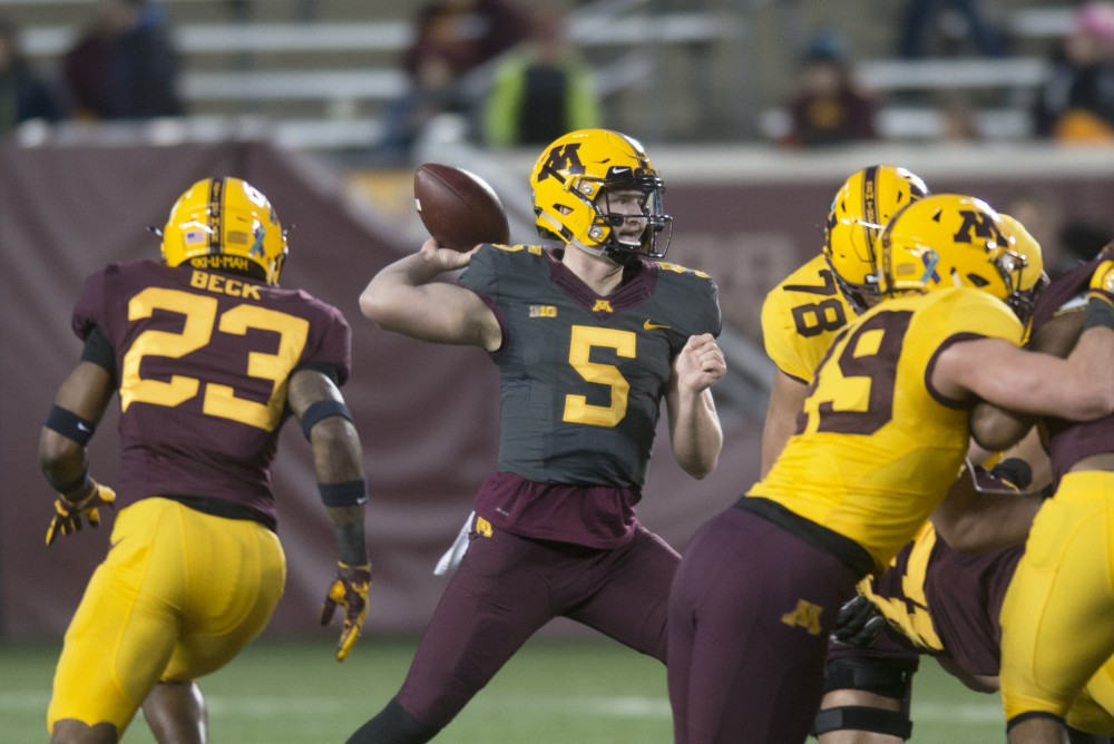 Quarterback Zack Annexstad throws the ball during the Gophers football spring game at TCF Bank Stadium on Thursday, April 12.