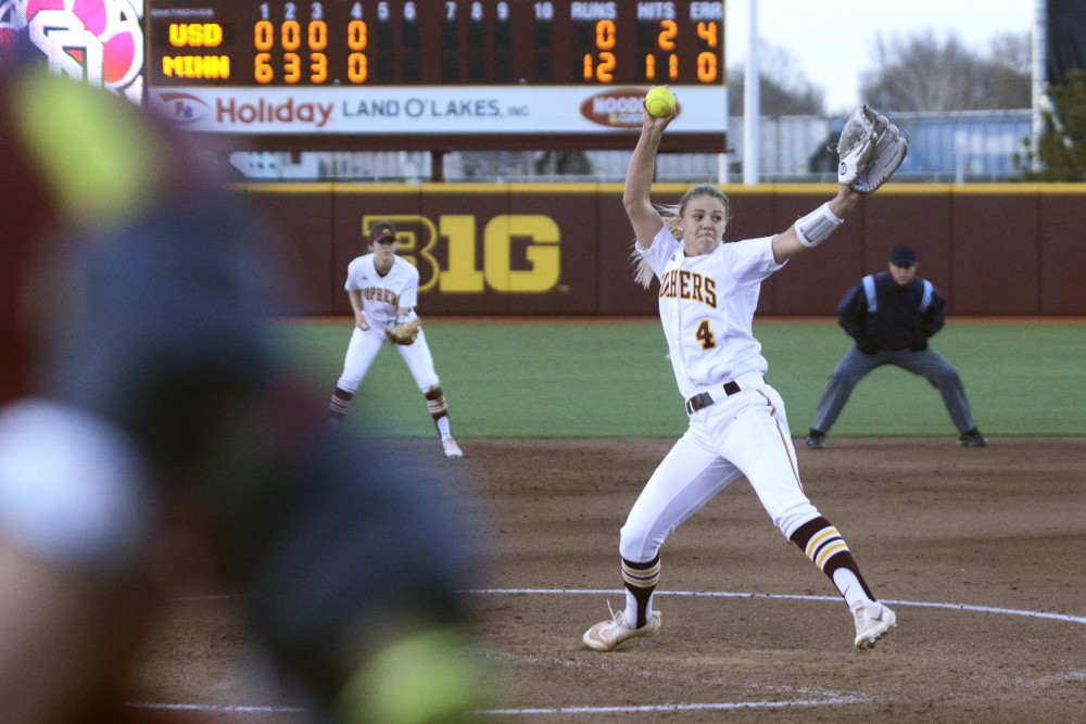 Utility Carlie Brandt winds up for a pitch during the game against the University of South Dakota on April 4, 2017.