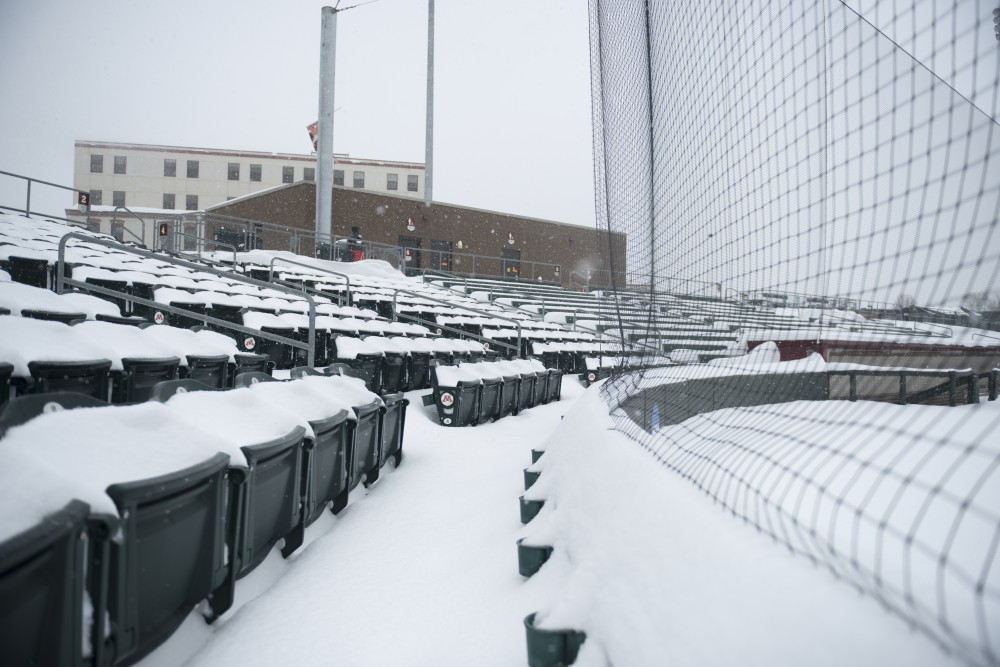 Snow covers Siebert Field during a blizzard on Sunday, April 15, 2018.