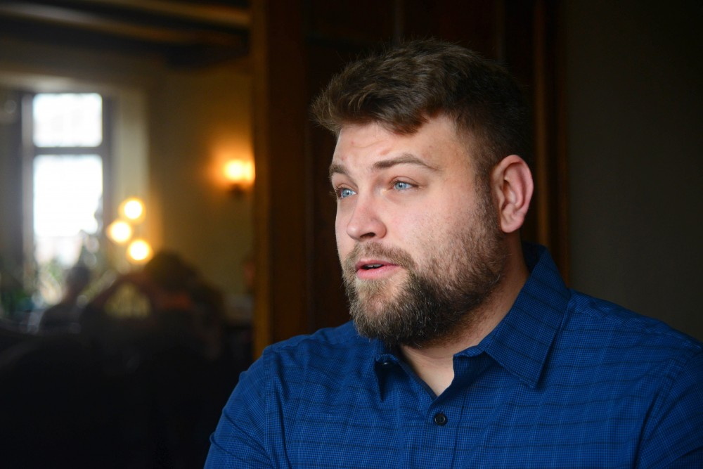 Cody Olson talks about his time with the Southeast Como Improvement Association at Bordertown Coffee on Thursday, April 12. Olson began working for the organization through a service-learning class his freshman year at the U and went on to the become its executive director.