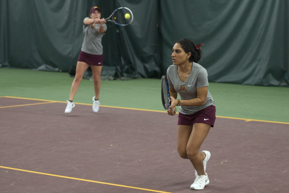 Junior Caitlyn Merzbacher returns the ball to the University of Northern Iowa with partner Mehvish Safdar at the Baseline Tennis Center on Friday, Jan. 26.