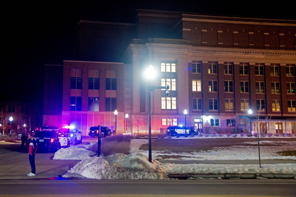 Several police cars sit outside of Northrop's west entrance following an incident during Somali Night 2018 Friday, April 20.