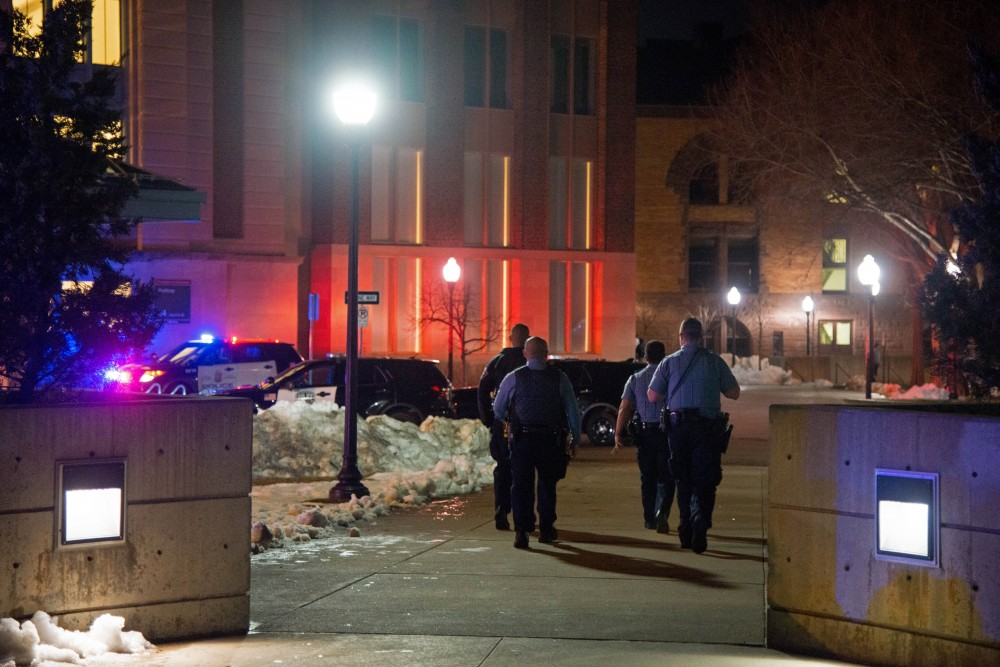 Minneapolis Police walk towards Northrop following an incident during Somali Night 2018 on Friday, April 20. Around 25 UMPD and MPD squad cars surrounded Northrop, limiting access to Pleasant and Church St. Friday night.