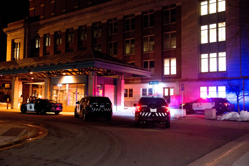 Several police cars sit outside of Northrop's east entrance following an incident during Somali Night 2018 on Friday, April 20. Around 25 UMPD and MPD squad cars surrounded Northrop, limiting access to Pleasant and Church St. Friday night.