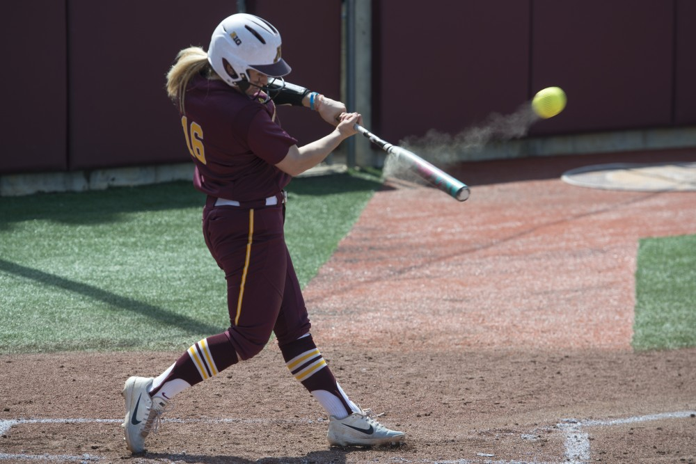 Infielder Allie Arneson swings at bat at the Jane Sage Cowles Stadium on Saturday, April 21, 2018. The Gophers defeated Nebraska 6-0.